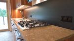 Kücher aus Ulme mit Wachenzeller Dolomit und Schwarzstahl - Holzquadrat OHG